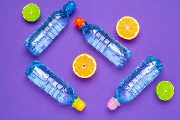 Citrus infused water bottle, flat lay, top view Premium Photo