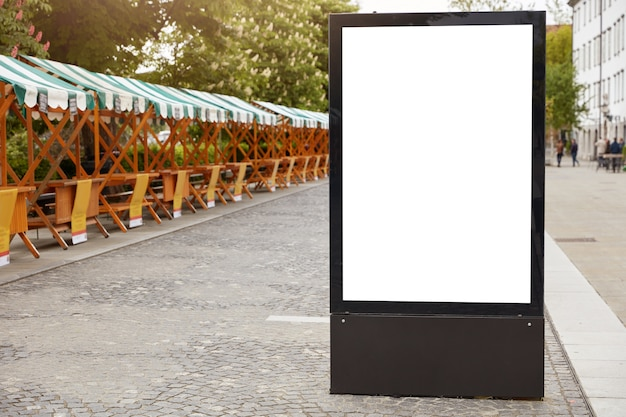City format. vertical lightbox with white mock up space for your announcement Free Photo