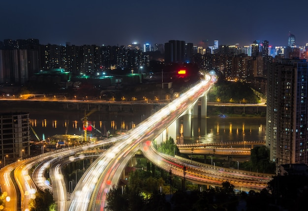 City interchange overpass at night with purple light show in chong qing Free Photo