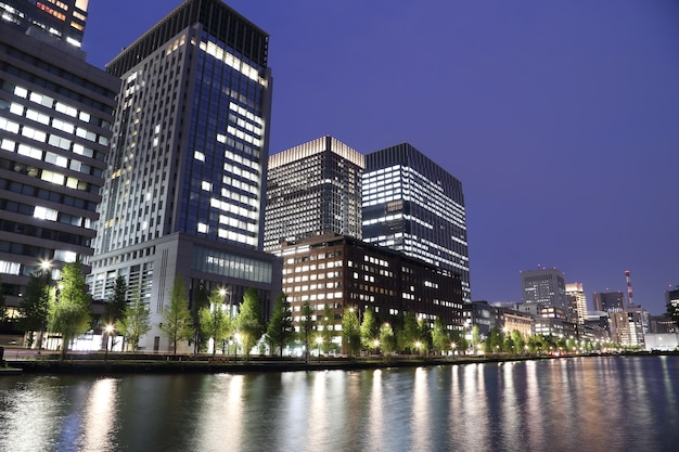 The city lights of tokyo reflect off of the water Premium Photo