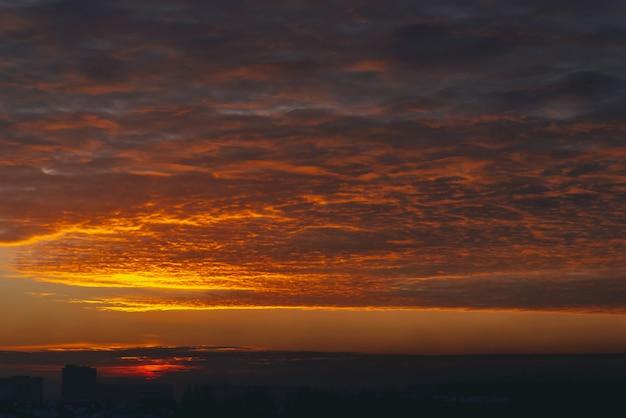 Cityscape with vivid fiery dawn Premium Photo