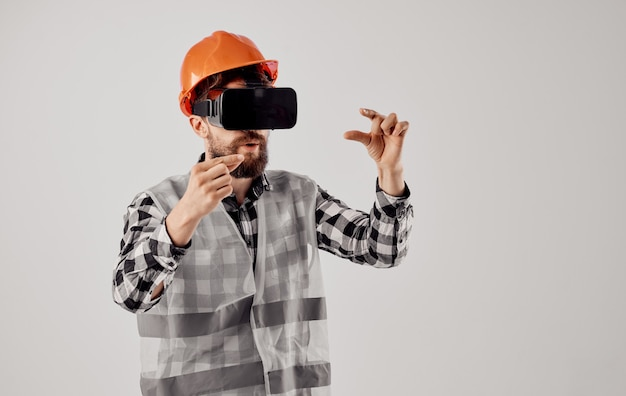 Civil engineer wearing 3d virtual reality glasses and an orange hard hat on his head. high quality photo Premium Photo