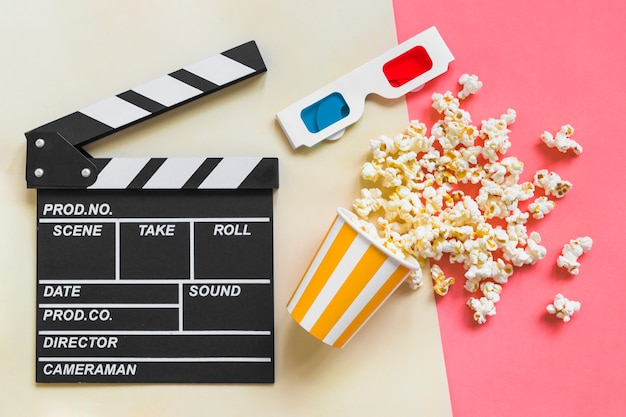 Clapboard near 3d glasses and popcorn Free Photo