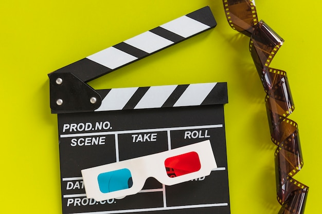 Clapboard near carton 3d glasses and tape Free Photo