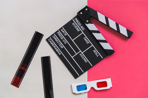 Clapboard near carton 3d glasses Free Photo