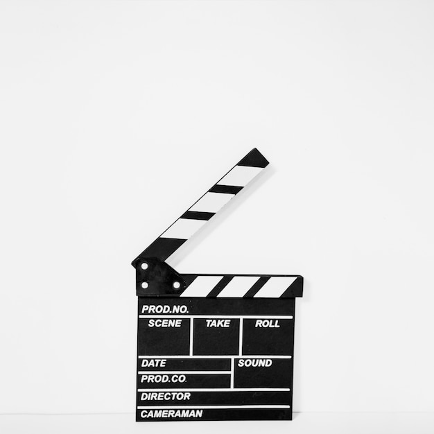 Clapperboard on white backdrop Free Photo