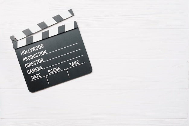 Clapperboard on white wooden table Free Photo