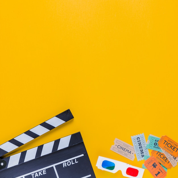 Clapperboard with cinema tickets and 3d glasses Free Photo