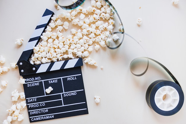 Clapperboard with film stock Free Photo