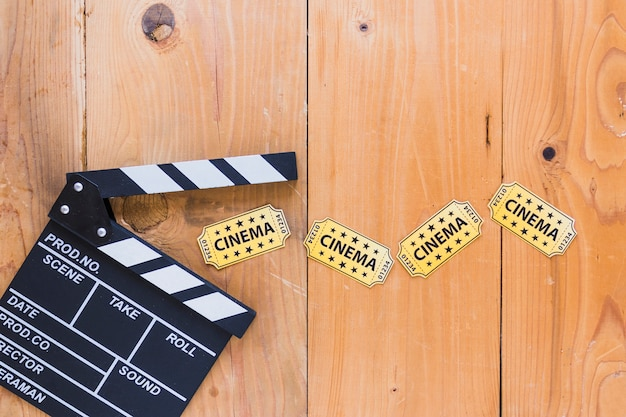 Clapperboard with paper tickets Free Photo