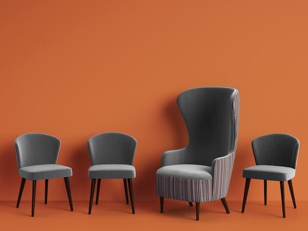 Classic armchair among simple chairs in grey color with copy space Premium Photo