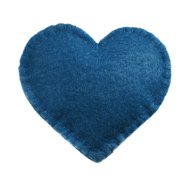 Classic blue felt heart on white. top view. isolated. concept trendy color of the 2020 year. Premium Photo