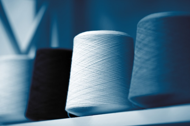 Classic blue threads, skeins and tangles of italian wool yarn, knitting needles. Premium Photo