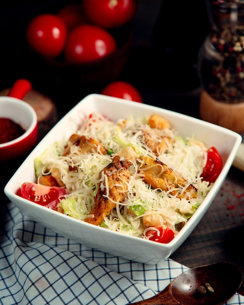 Classic caesar salad with chicken Free Photo