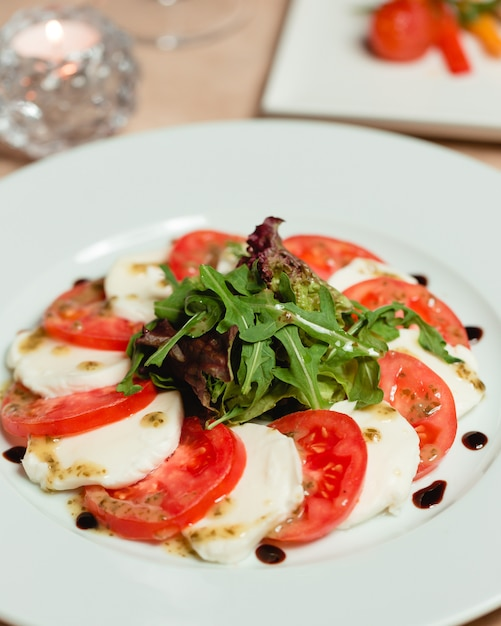 Classic caprese salad with mozzarella cheese and tomatoes Free Photo