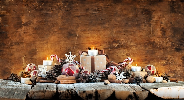 Classic christmas composition with candles on wooden background Premium Photo