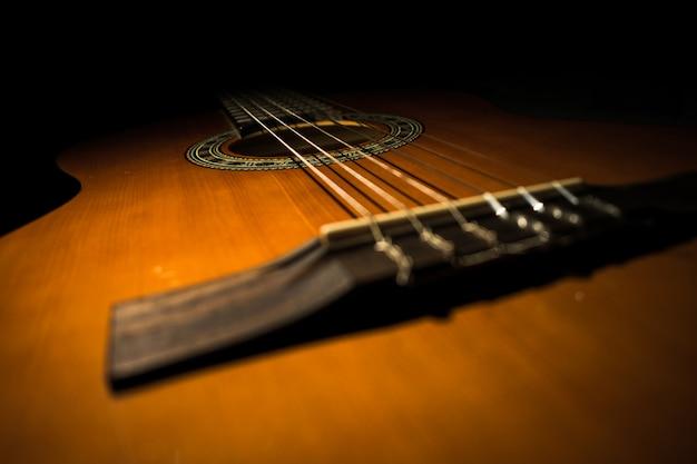 Classic guitar with black background Premium Photo