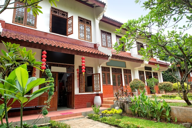 Premium Photo Classic House With Chinese Wooden Windows And Doors Decoration Red Lanterns And Trees