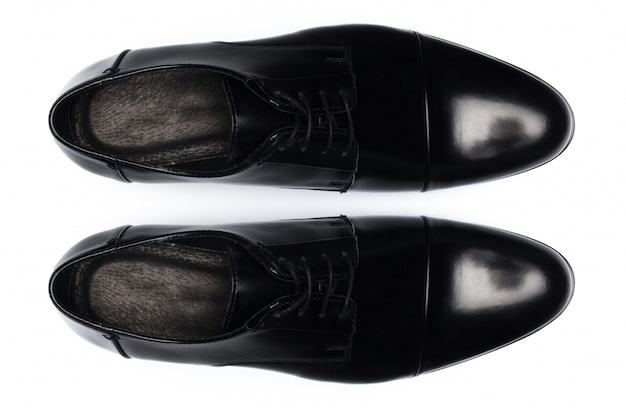 Classic male leather shoes isolated on a white, top view. Premium Photo