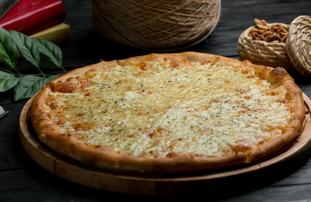 Classic margarita pizza with full parmesan cheese Free Photo