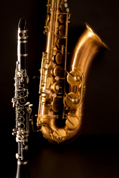 Classic music sax tenor saxophone and clarinet in black Premium Photo