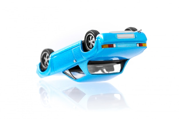 Classic toy cars accident in overturned composition with side view profile Premium Photo