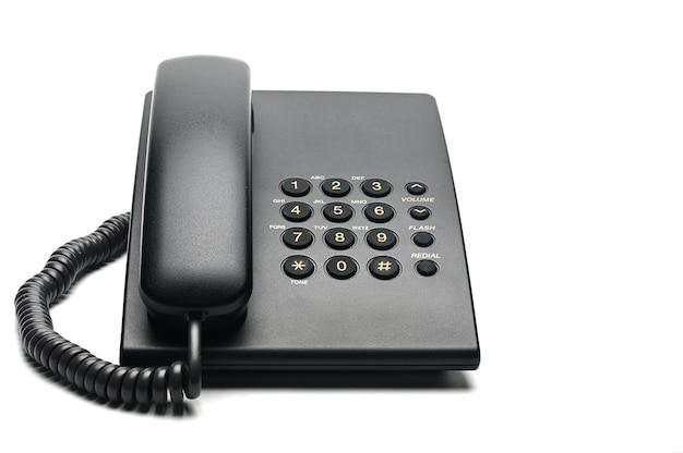 自宅やオフィスで使用される白のクラシックな有線電話。 Premium写真