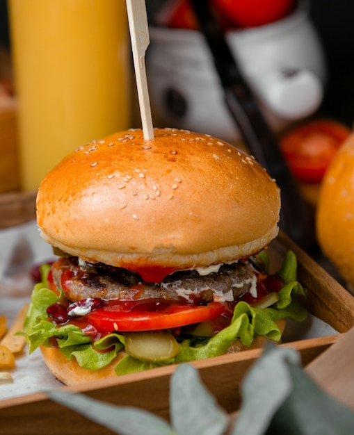 Classical burger with sesame bun Free Photo