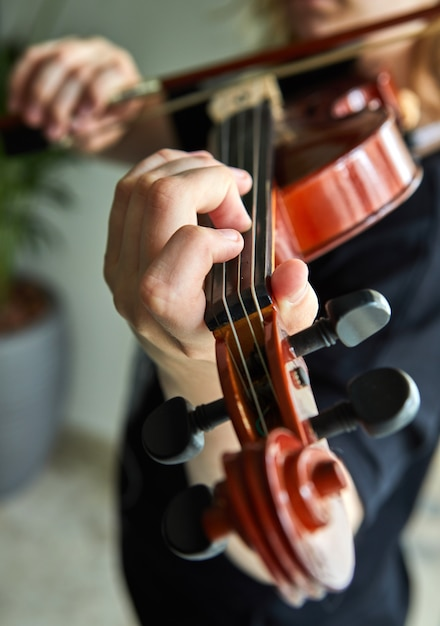 Classical player hands. details of violin playing. Premium Photo