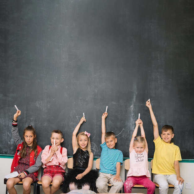 Classmates with chalk together Free Photo