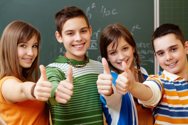 classmates with the thumb up in a classroom photo free download