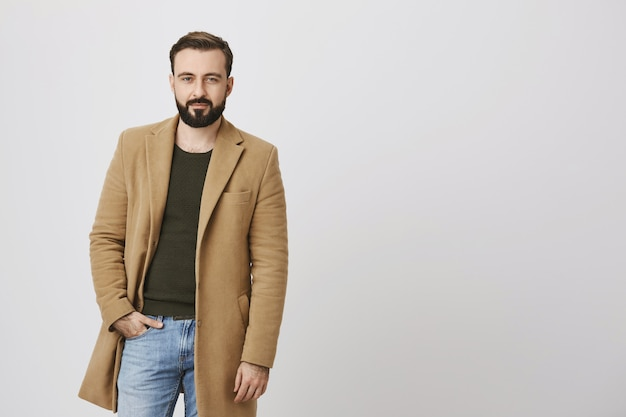 Classy good-looking bearded man smiling Free Photo