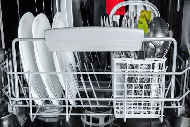 Clean dishes after washing in the dishwasher Premium Photo