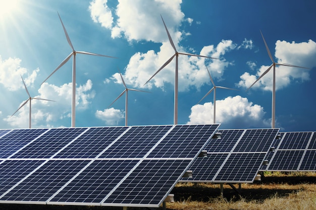 Clean energy power concept solar panel with wind turbine and blue sky background Premium Photo