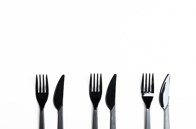 Clean plastic black forks and knives Premium Photo