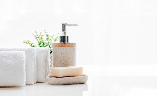 Clean soft terry towels with soap on white table, copy space.