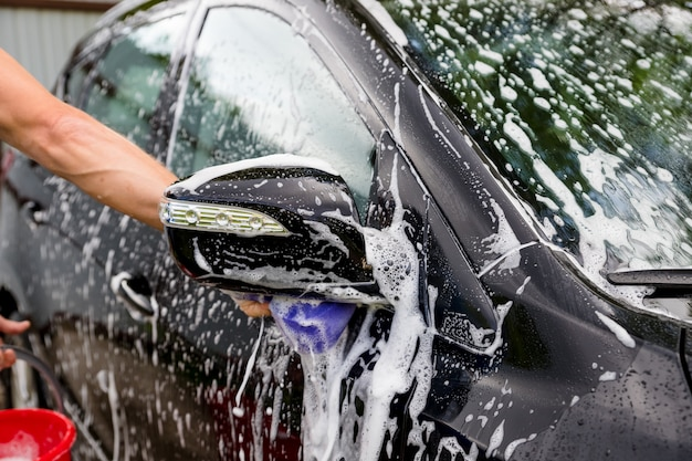Cleaning automobile with high pressure water Premium Photo