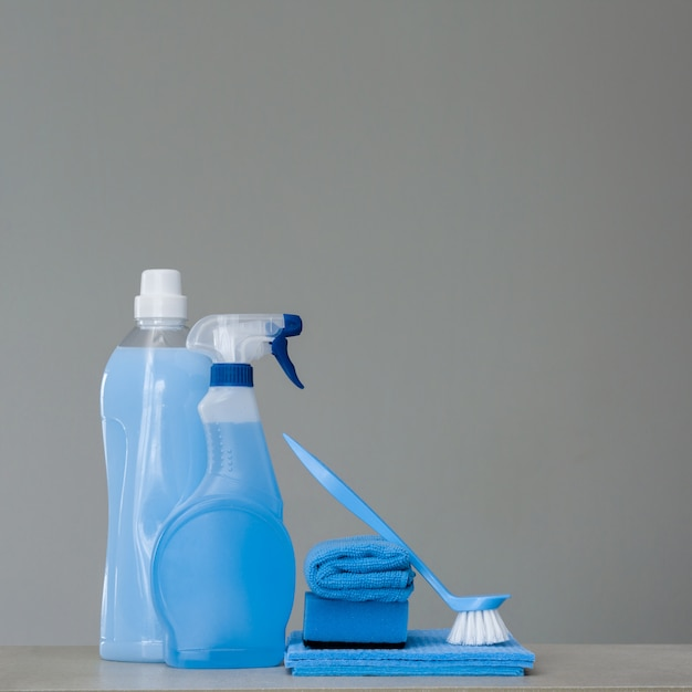 Cleaning blue set on grey background. cleaning tools and products Premium Photo
