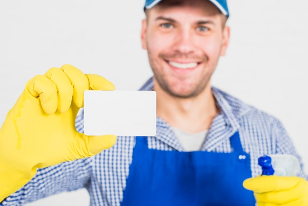 Cleaning concept with man showing business card Free Photo