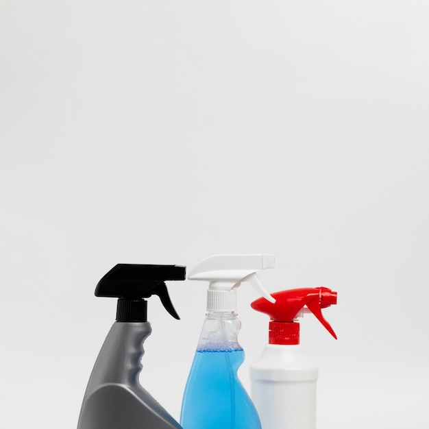Cleaning concept with spray bottles Free Photo