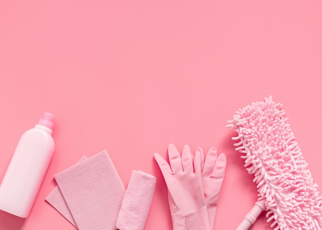 Cleaning kit in the house pink on a pink background. Premium Photo