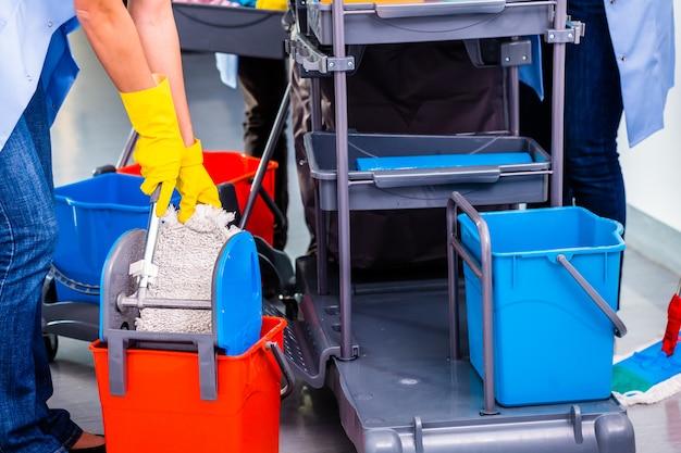 Cleaning ladies mopping floor Premium Photo