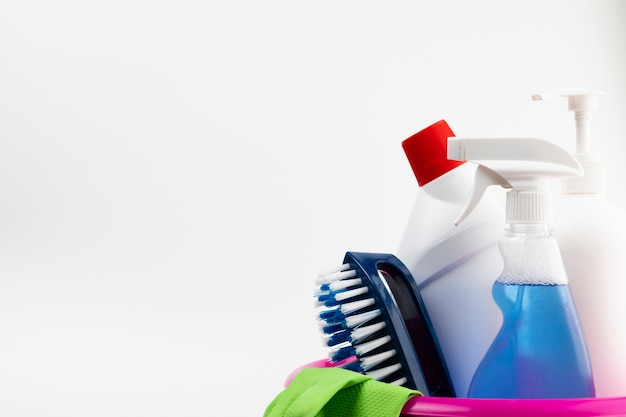Cleaning products and gloves in pink basin Free Photo