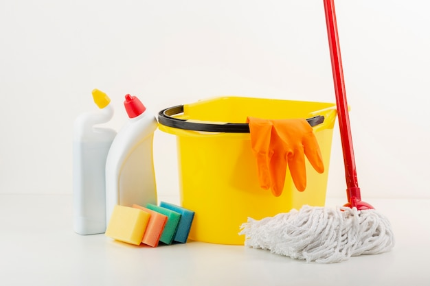Cleaning products and mop front view Free Photo