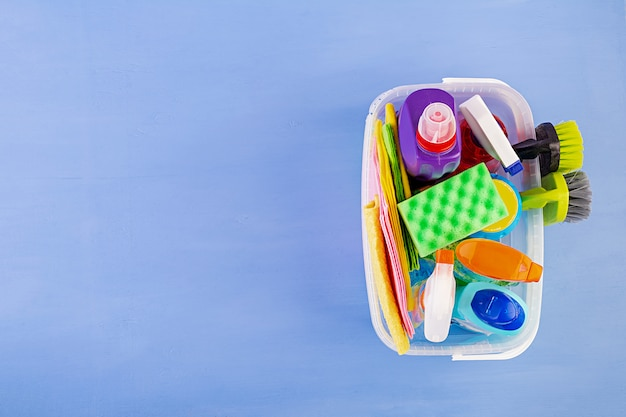 Cleaning service concept. colorful cleaning set for different surfaces in kitchen, bathroom and other rooms. top view Premium Photo