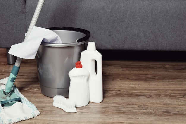 Cleaning tool set on the wooden floor Free Photo