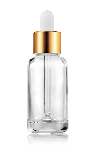 Clear glass serum bottle for cosmetic products design mock-up Premium Photo