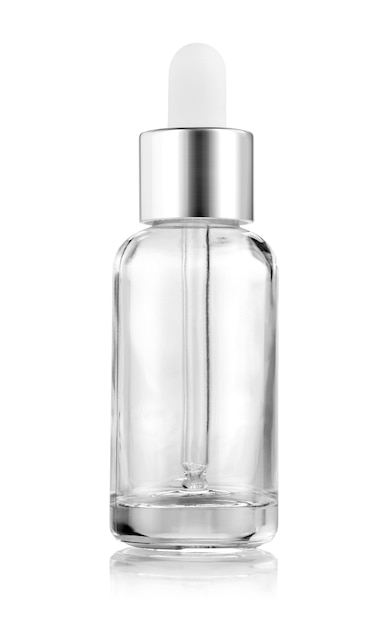 Clear glass serum bottle for cosmetic products Premium Photo