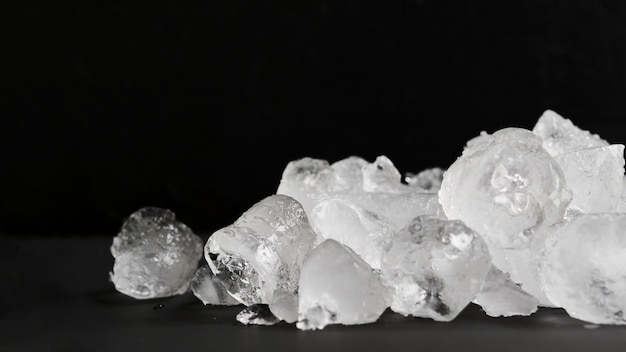 Clear ice lying in pile Free Photo
