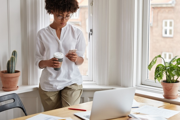 Clever female magazine editor working at home Free Photo